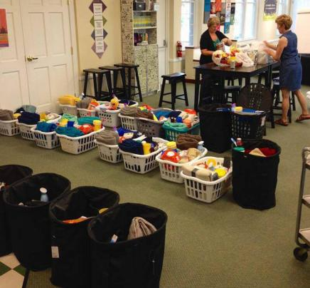 Packing laundry baskets of supplies